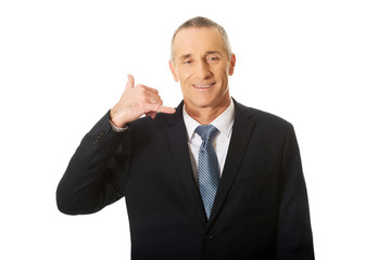 Businessman with call me gesture
