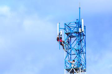 Technician repairing on telecommunication tower