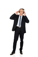 Full length businessman with big headphones