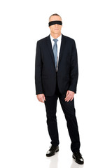 Full length businessman with band on eyes