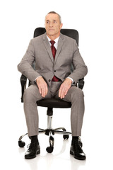 Front view of businessman sitting on armchair