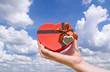 Hand holding a heart shaped box