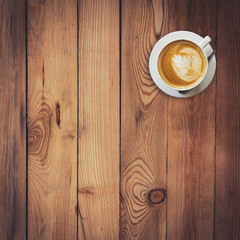 Latte coffee on wood with space