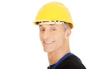 Smiling builder with a safety helmet