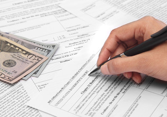 Person filling bankruptcy form