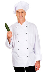 Male chef with a cucumber