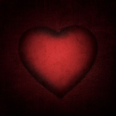 red paper heart on the fabric. light effect