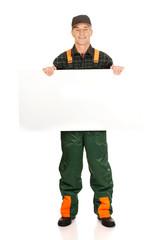 Gardener in uniform showing empty banner