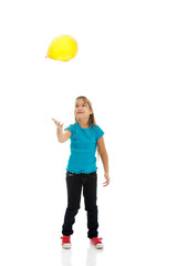 Girl with baloons looking up