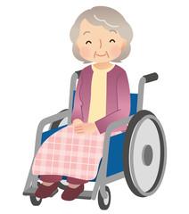車椅子に乗る高齢者 女性