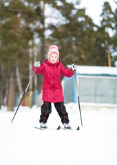 child engaged in skiing to  winter
