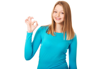 Young woman showing perfect sign