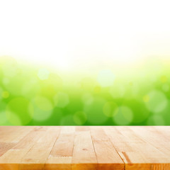 Wood table top on white green bokeh abstract background