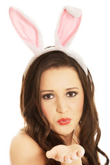 Woman wearing bunny ears and blowing a kiss
