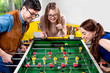 Friends playing table football - 76791290