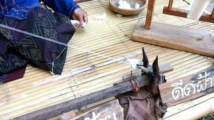 Cotton Spinner by local farmer on the bamboo bench