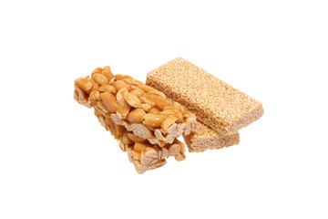 Peanut brittle with sesame seeds and peanuts.