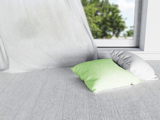 two pillows near the window