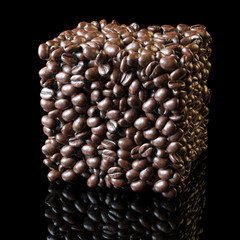 Square made of roasted coffee beans on black background