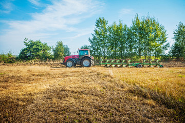 agricultural processing tractor plowing field