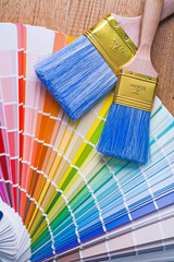 color palette and paintbrushes on wooden board