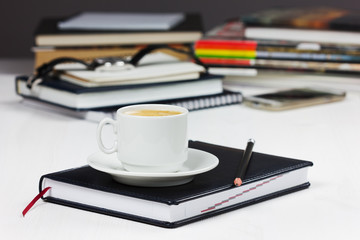 workplace with business diary, pencil and cup of coffee.