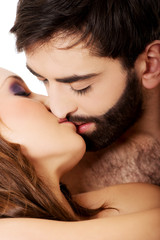 Sexy heterosexual couple kissing.