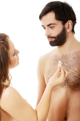 Woman giving a condom to her man.