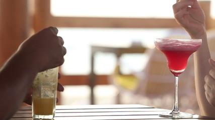 women drink red cocktail and splashing cocktail on the dark-skin