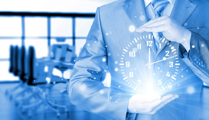 Image of businessman holding clock against illustration
