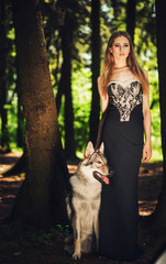 graceful girl standing with a dog