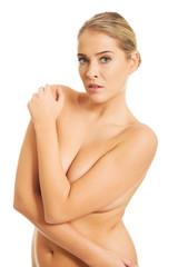 Topless woman looking at camera