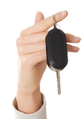 Close up on female hand holding a car key