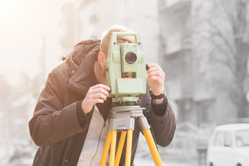 Theodolite measuring on a construction site.