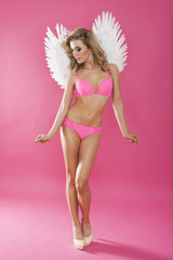 Sensual and feminine woman with angel's wings