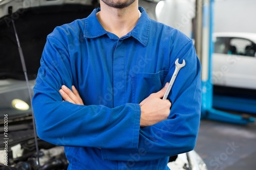 canvas print picture Mechanic standing with arms crossed