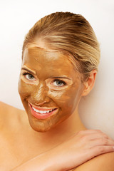 Portrait of happy woman with chocolate mask