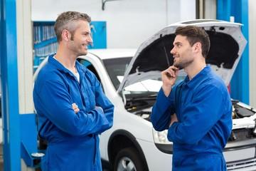 Team of mechanics talking together