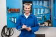 canvas print picture - Smiling mechanic looking at camera
