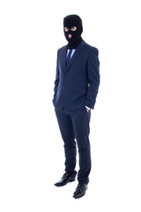 fraud concept - man in business suit and black mask isolated on