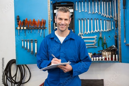 canvas print picture Smiling mechanic looking at camera