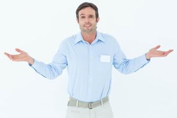 Businessman shrugging shoulders over white background