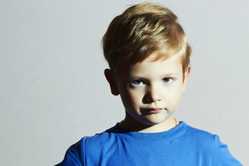 serious Child.Little Boy with Blue Eyes.Children emotion