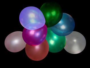 group of color balloons isolated on black