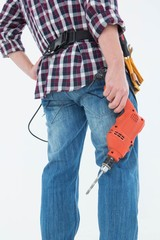 Male handyman holding drill machine