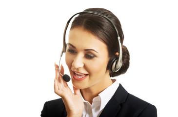 Portrait of happy phone operator in headset