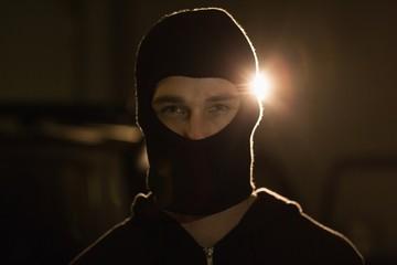 Criminal in balaclava looking at camera