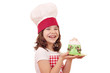 happy little girl cook with cupcakes