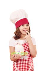 happy little girl cook eat cream