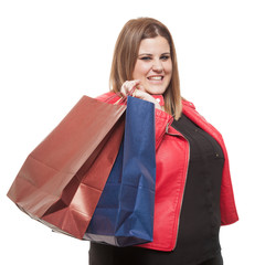 Plus size woman holding shopping bags